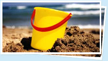 yellow bucket on teh beach