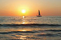 sailboat on the ocean during a sunset